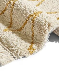 Hoogpolig vloerkleed Ruby - crème/goud - close up