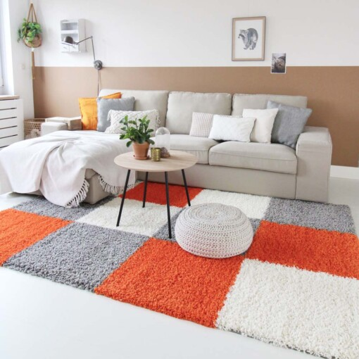 Hoogpolig vloerkleed oranje blokken voorkant