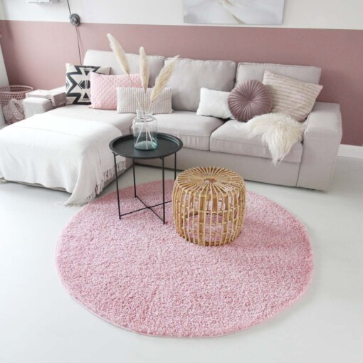 Hoogpolig vloerkleed roze rond voorkant 2