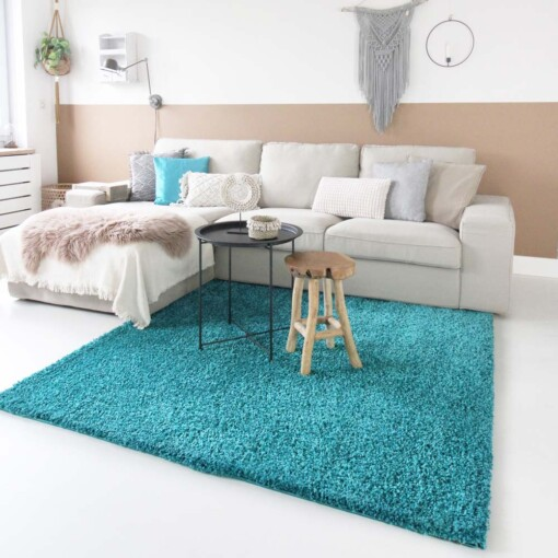 Hoogpolig vloerkleed turquoise vierkant voorkant 2