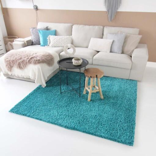 Hoogpolig vloerkleed turquoise vierkant voorkant