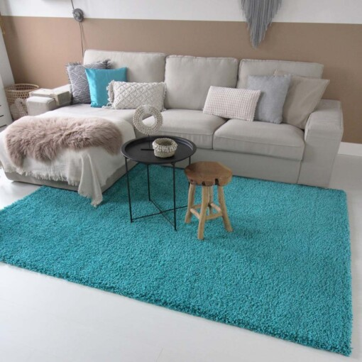 Hoogpolig vloerkleed turquoise voorkant 2