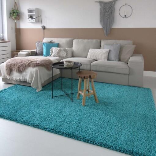 Hoogpolig vloerkleed turquoise voorkant